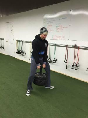 """Emily doing a """"duck walk"""" with 220lbs."""